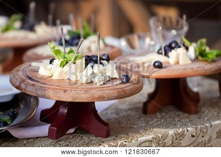 Several cheese of plates on the table