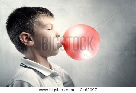 Child blowing a bubble gum