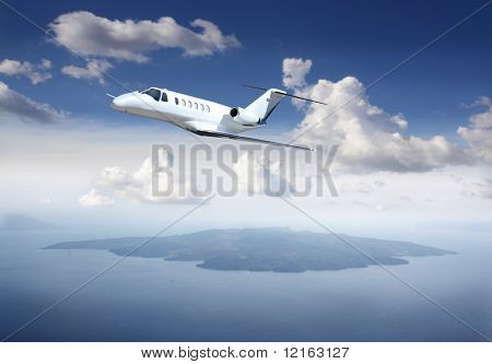 Airplane flying over an island