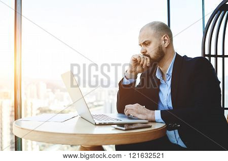 Businessman looking concerned with results of last meeting with investors.