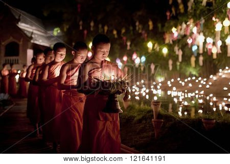 CHIANG MAI - THAILAND / 25.11.2015: Yi Peng Festival, Buddhist monk fire candles to the Buddha and floating lamp on November 24, 2015 in Phan Tao Temple, Chiangmai, Thailand.