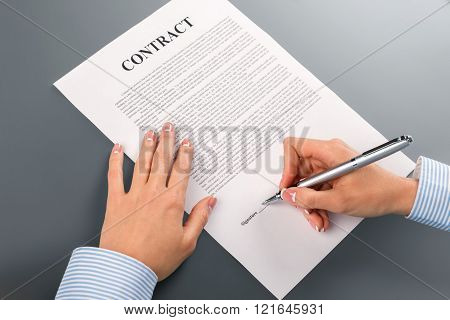 Female hand signs cooperation contract.