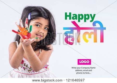 indian little girl with colours in palm, happy holi greeting