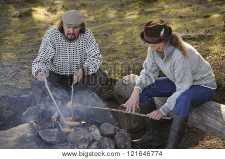 Couple Grilling Sausages