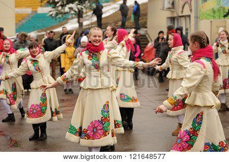 Orel, Russia - March 13, 2016: Maslenitsa, Pancake Festival. Girls In White Slavonic Clothes Dancing