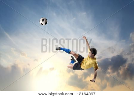 Soccer player shooting a football