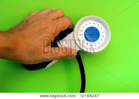 blood pressure check with an aneroid sphygmomanometer