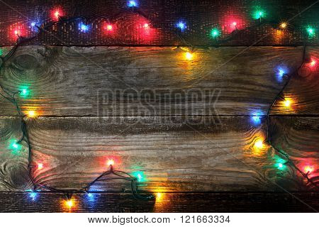 Frame of the colorful festoon on the wooden board