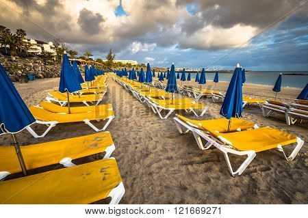 Beautiful Sun Loungers With Parasols On The Beach