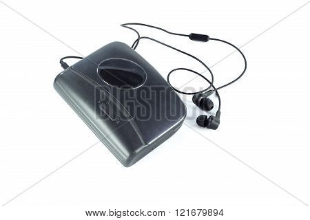 Old fashioned music of cassette player and black earphones isolated on white background