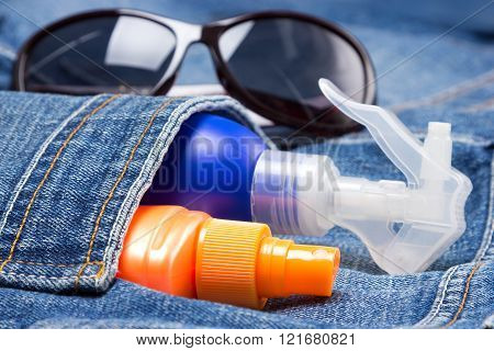 Cosmetic Sunscreen Products In Jeans Pocket