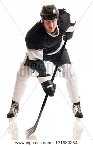 Ice hockey player. Studio shot over white.