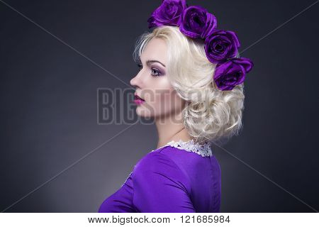 Portrait Of Blond Caucasian Woman Wearing Violet Flowery Vivid And Bright Crown. Posing On Black.