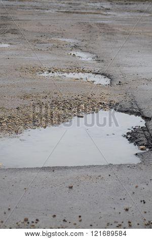 Broken dirty road
