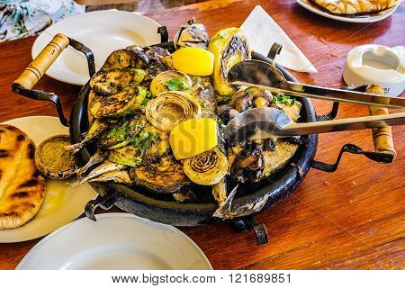 Bulgarian Hot Plate With Fish, Courgettes And Onions