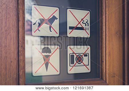 No Sign, No Dogs, No Smoking, No Photo, No Icecream Signs On Door