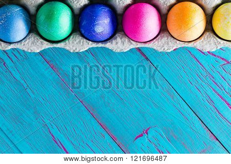 Colorful Easter Egg Frame On Exotic Blue Copyspace