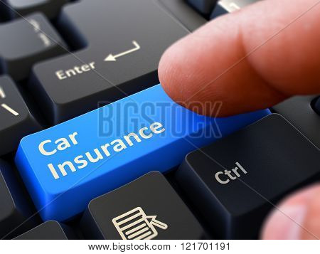 Pressing Blue Button Car Insurance on Black Keyboard.
