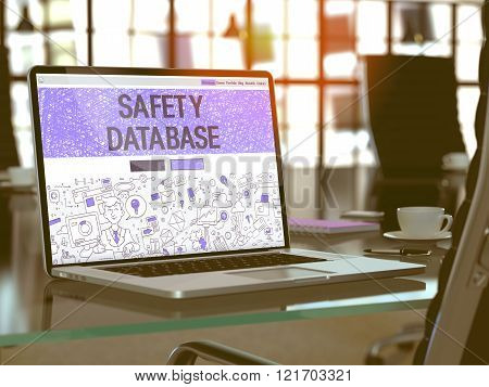 Safety Database on Laptop in Modern Workplace Background.