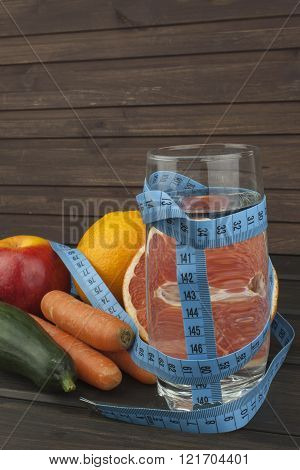Dietary adherence to the diet program. Fresh dietary food for athletes. Fruit on a wooden table