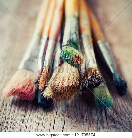 Bunch Of Old Artist Paintbrushes On Wooden Rustic Table. Close Up On Bristle.
