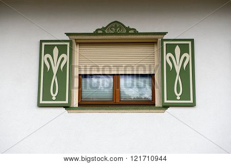 Typical nicely painted shutters on a typical Austrian house on the countryside