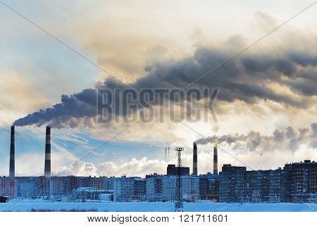 Smokestacks Polluting The Air Over The City.
