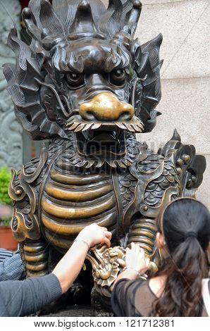 Worshippers Touching Dragon at Wong Tai Sin Temple, Hong Kong