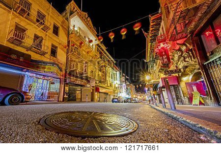 San Francisco, USA - JUNE 24, 2015. Street view of Chinatown in San Francisco at night depicting the colorful traditional Chinese architecture