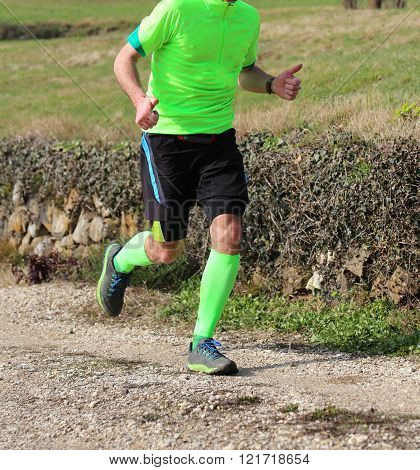 Sportsman Racer With Running Shoes Runs During Cross Country Race