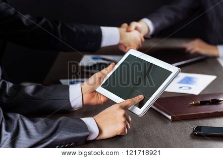 Business Meeting. Group Of Business People Working With Digital Tablet.