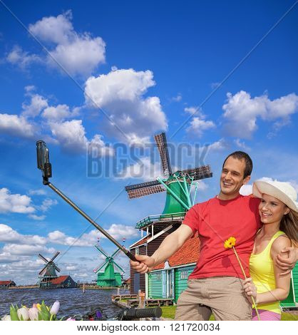 Selfie Against Canal With Windmills In Zaanse Schans, Holland