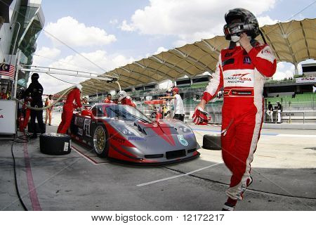 SEPANG, MALAYSIA - AUGUST 8: A Honda Team driver walks by after changing of drivers at the 12 hour race of the 2009 Merdeka Millennium Endurance Race August 8, 2009 in Sepang, Malaysia.