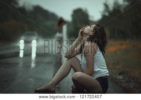Woman In The Rain And Sad.