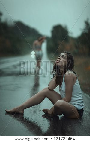 Woman suffering in the rain.