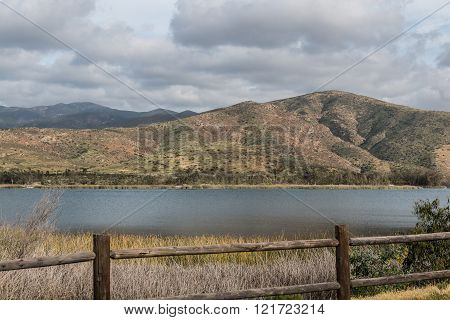 Clouds over a Mountain Range and Lake in Chula Vista, California