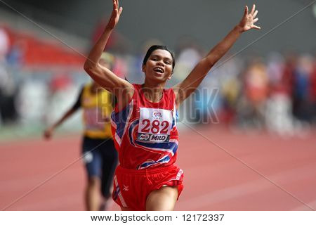 KUALA LUMPUR - AUGUST 15: Thailand's visually impaired athlete Phimnara Piamthanakankun celebrates at the track and field event of fifth ASEAN Para Games August 15, 2009 in Kuala Lumpur.