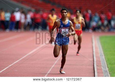 KUALA LUMPUR - AUGUST 15: Thailand's visually impaired athlete wins the 800m race at the track and field event of the fifth ASEAN Para Games on August 15, 2009 in Kuala Lumpur.