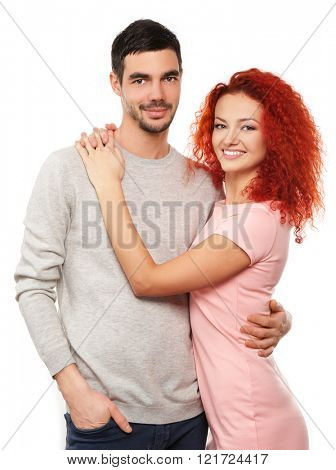 Happy young couple in love embracing, isolated on white