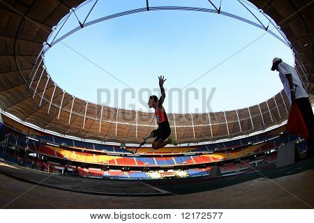 KUALA LUMPUR - AUGUST 17: Thailand's amputee athlete Tawarchai Morapat winning the long jump event of the fifth ASEAN Para Games on August 17, 2009 in Kuala Lumpur, Malaysia.