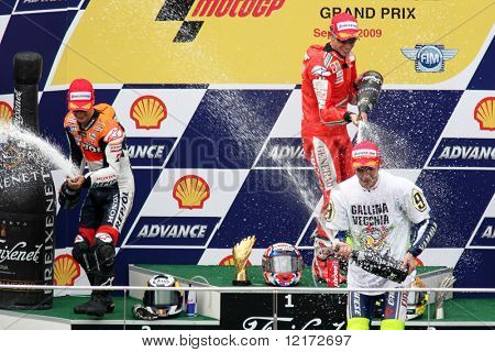 SEPANG, MALAYSIA - OCTOBER 25: Winners of the MotoGP race celebrating on the podium at the 2009 Shell Advance Malaysian Motorcycle GP. October 25, 2009 in Malaysia.
