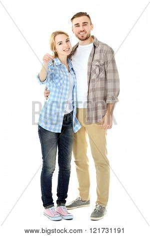 Happy young couple with keys from new house isolated on white