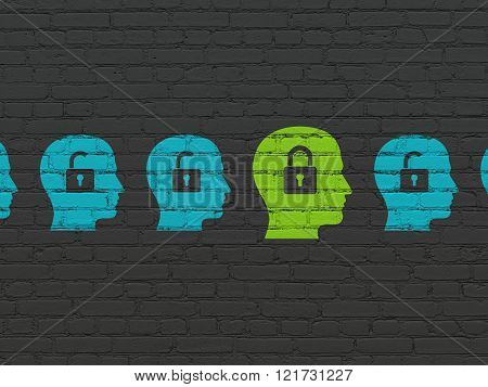 Privacy concept: head with padlock icon on wall background