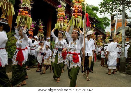 BALI - JANUARY 14: Village women carry offerings of food baskets on their heads in a procession to the village temple January 14, 2010 in Bali, Indonesia.