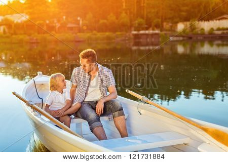 Dad and son in boat in summer