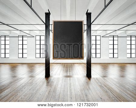 Photo of empty museum interior in modern building.Open space loft.Empty black canvas hanging on the