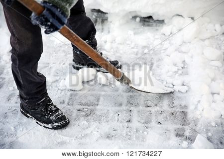Man clearing street from snow