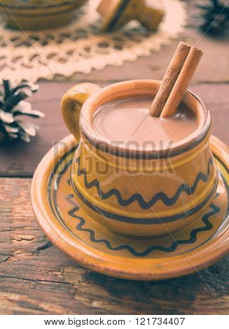 Hot chocolate with cinnamon in a rustic ware