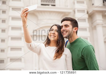 Couple of tourists taking selfies