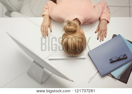 Tired woman at the computer in office
